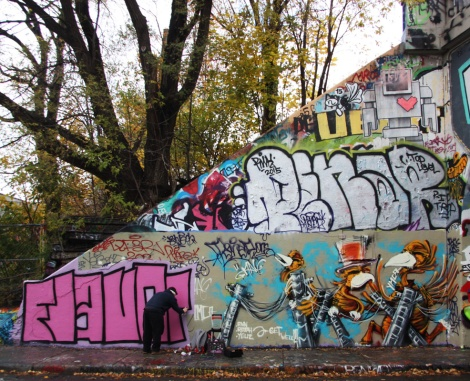 Max (right) at the Halloween jam at the Rouen legal graffiti tunnel; also visible is a work in progress by Flavor (bottom left), a throwie by Penar (middle) and a Lovebot wheatpaste (top)
