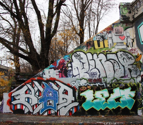 Kube (bottom left), Lect (bottom right), Penar (middle) and a wheatpaste by Lovebot (top) at the Rouen legal graffiti tunnel