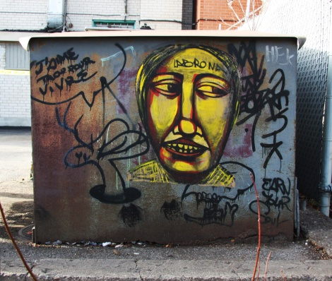 Labrona wheatpaste (right) and Lapin drawing (left), in Hochelaga