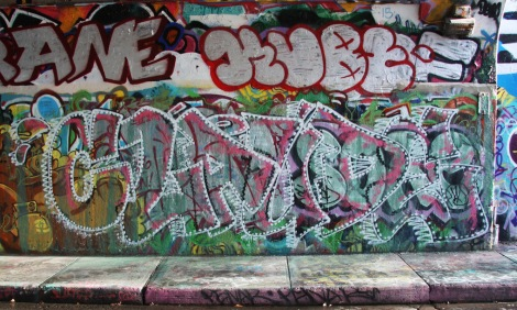 Claude at the Rouen legal graffiti wall; above is a throwie by Kube