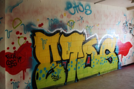 Etos graffiti piece found in an abandoned school