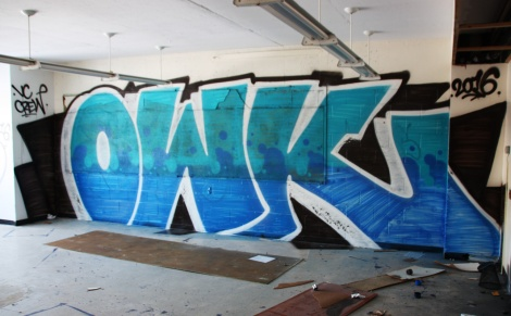 Owk graffiti piece found in an abandoned school