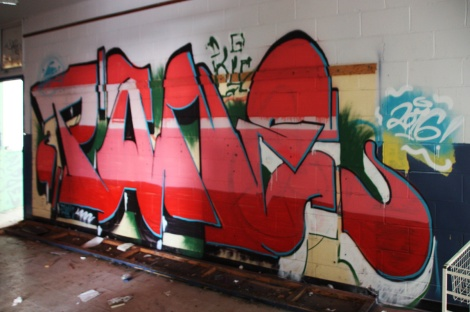 Pane graffiti piece found in an abandoned school