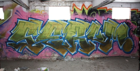 Serum graffiti piece found in a stable of the abandoned Montreal Hippodrome