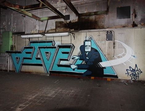 Five Eight (letters) and Earth Crusher (character) in the basement of an abandoned industrial building