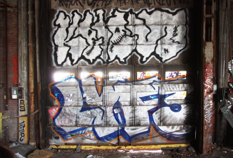Kelen (top) and Lyfer (bottom) piece in abandoned building