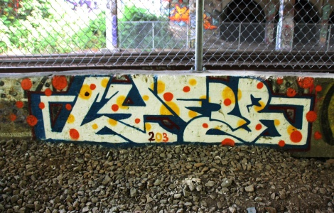 Lyfer piece next to train tracks