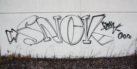 outline by Snok on one of the abandoned Transco's outer walls