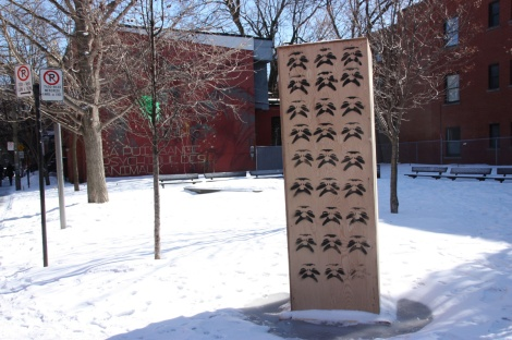 Jest stencil over the wooden protection installed around the statue dedicated to Claude Jutras following the recent controversy around this famous québécois movie director's alleged pedophilia.