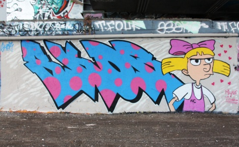 Skor on letters and his girlfriend MlyneFortier at the Papineau legal graffiti wall