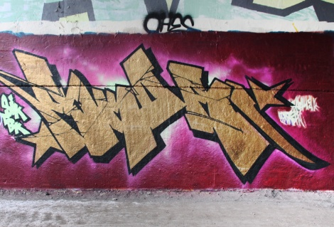 Skor at the Papineau legal graffiti wall (writer ran out of paint on the right; image cropped on the left)