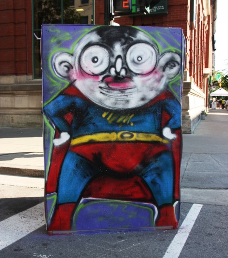 IAmBatman on the reverse of an information board for the 2016 edition of Mural Festival