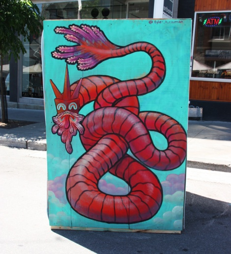 Tyler K Rauman on the reverse of an information board for the 2016 edition of Mural Festival