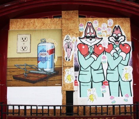 Mr Crocks (left) and Tava (right) wheatpastes on the boarded Club Sandwich hotel complex for the 2016 edition of the MTL En Arts festival