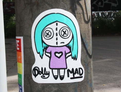 Dolly Deals wheatpaste in Mile-Ex