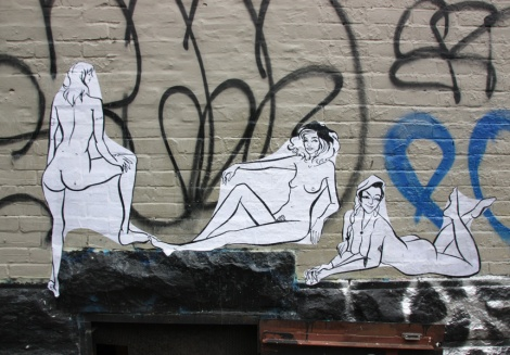 paste-ups by unidentified artist in the Plateau