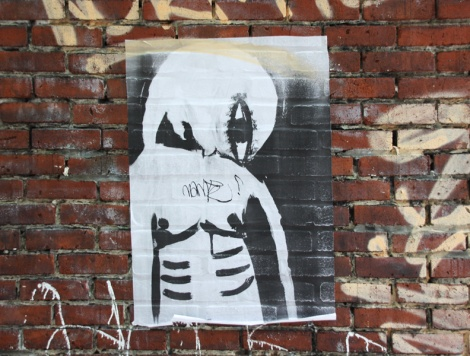 Poster by an unidentified artist in the alley between St-Laurent and Clark