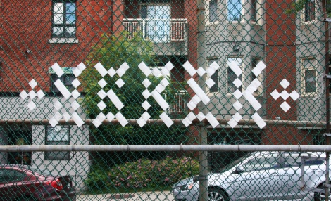 tape tagging on fence by Ygrek