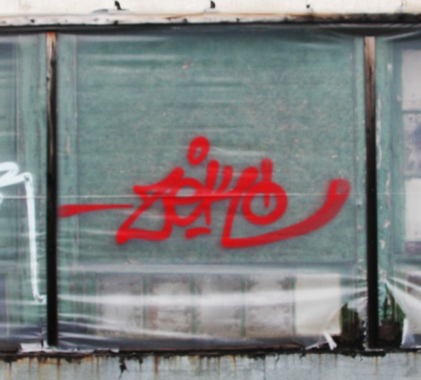 Zek tag on abandoned building
