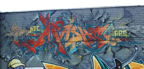 Apashe on a multi-artist wall in St-Henri