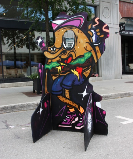 Ekes on a 'your face here' board for the 2017 edition of Mural Festival