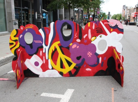 Naimo on a 'your face here' board for the 2017 edition of Mural Festival