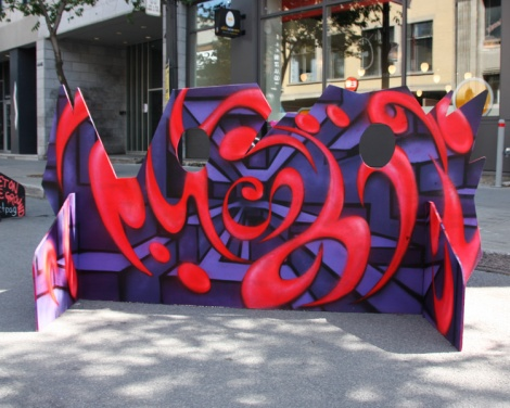 Hellp aka LP Montoya on a 'your face here' board for the 2017 edition of Mural Festival