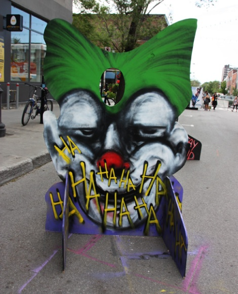 IAmBatman on a 'your face here' board for the 2017 edition of Mural Festival
