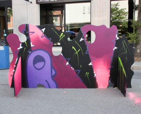 ROC514 on a 'your face here' board for the 2017 edition of Mural Festival
