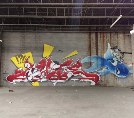 Awe (letters), Nick Sweetman (fish) and Axe Lalime (woman) in an abandoned warehouse