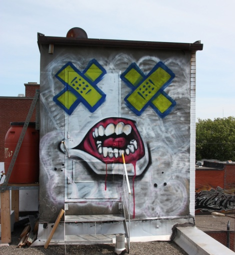 rooftop piece by Axe at the Plaza St-Hubert