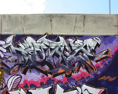 Close-up on Korb's piece on the Crazy Apes wall at Festival de Canes