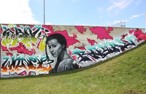 Next Time Crew wall at the Festival de Canes, featuring Rouks (character), Sank (top left), Wonez (bottom left) and Royal (right)