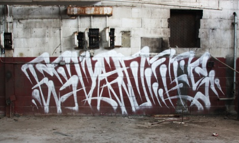 tag by Eskro inside an abandoned building