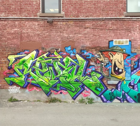 Rekal (letters) and Frank Bo (character) in a Plateau alley