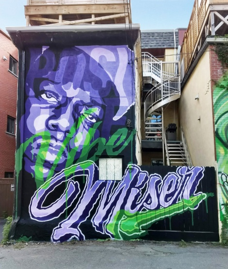 Miser mural in a Plateau alley