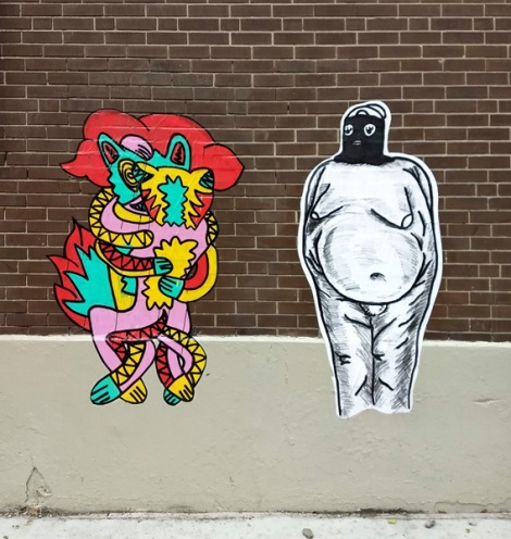 wheatpaste by Le Renard Fou (left) and Peau (right) in the Plateau