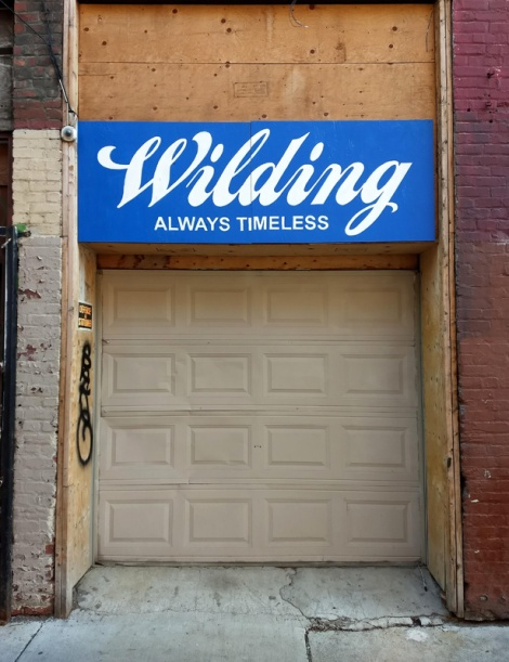 Mock storefront sign by Benny Wilding put up off Under Pressure
