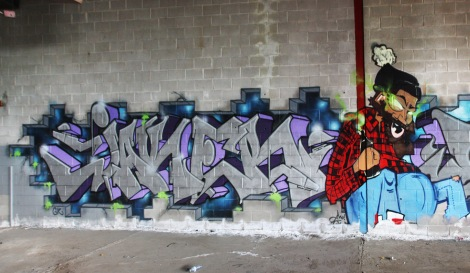 Jaker (letters) and Jmoe (character) in an abandoned building