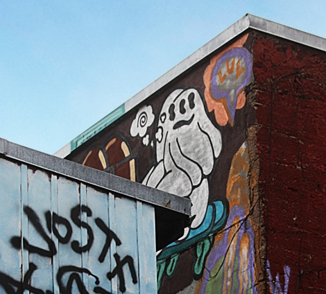 Germdee rooftop piece in a central graffiti alley