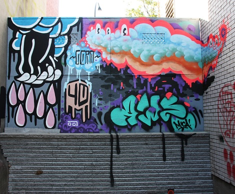 Germdee (left), Awe (bottom right) and Wzrds Gng (top right) in a Mile End alley