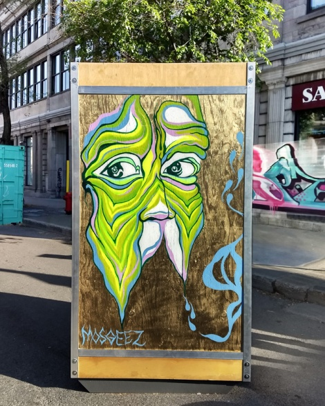 M'Os Geez on one of the info boards for the 2019 edition of Mural Festival