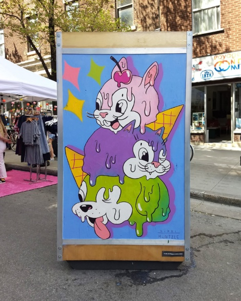 Nikki Küntzle on one of the info boards for the 2019 edition of Mural Festival