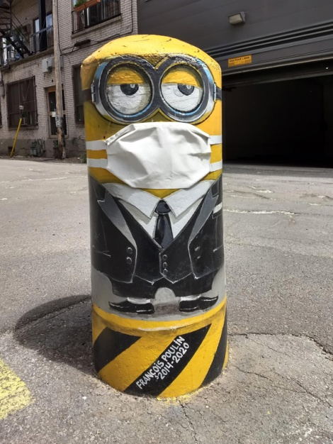bollard made into a mask-wearing minion by François Poulin