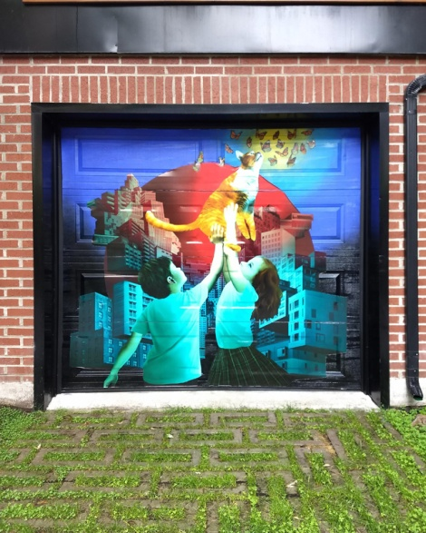 pasted art by Mirov on a Plateau garage door
