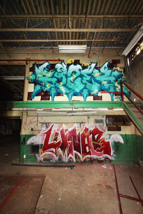 Rizek (top) and Luna (bottom) in an abandoned building